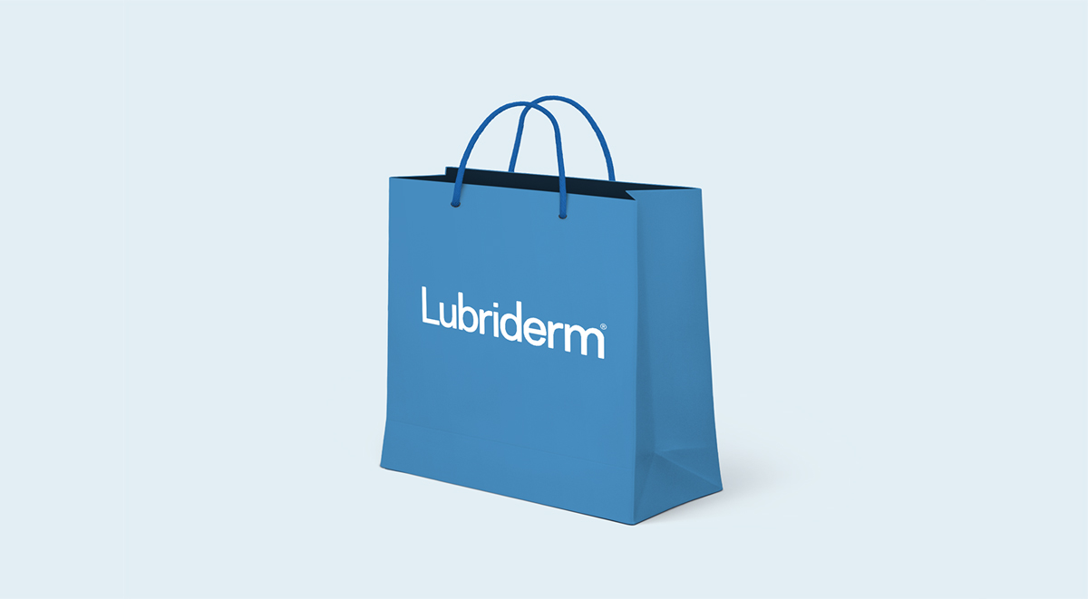 A shopping bag with the Lubriderm logo